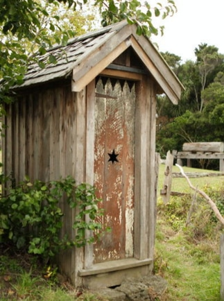 Toilet Outhouse a Wood Outdoor Bathroom. A landmark of old country life: The Gift Ideas List Site